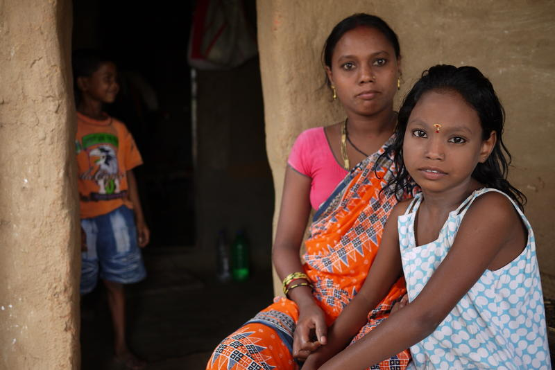Pujpha Bania, 33, and her daughter Manisha, 8, are migrant workers from Odisha state in northeast India. They travelled several days by train to work at a brick kiln near Hyderabad, India.