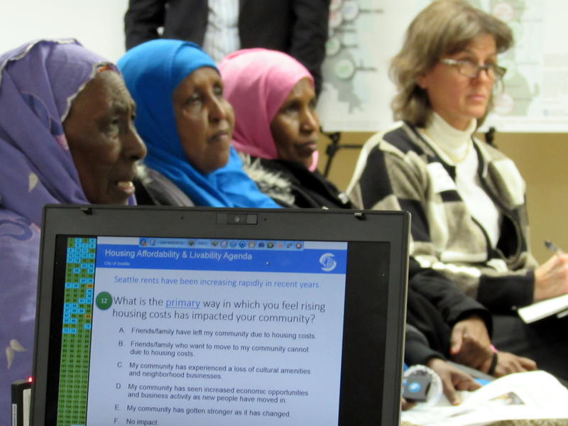 Audience members take an electronic survey at an open house on affordable housing at an Ethiopian community center in south Seattle.