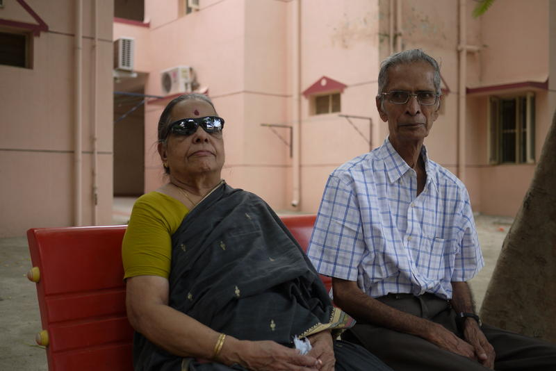 Mahadevan Iyer and a friend sit outside his apartment at a senior living community near Chennai, India.
