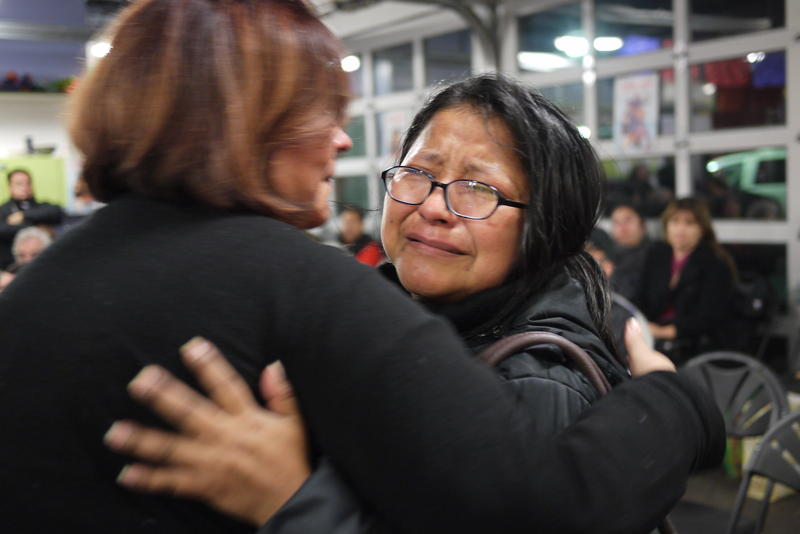 Nazaria Morales hugs a friend after Obama's announcement