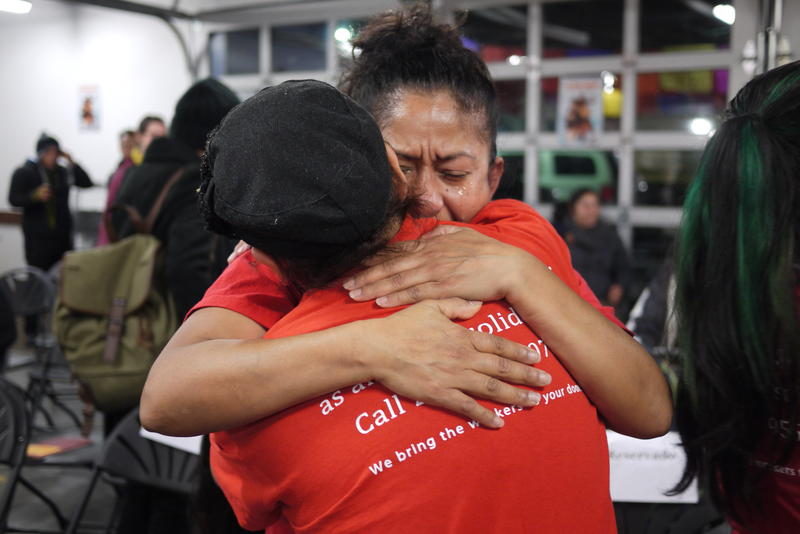 Sylvia Gonzales hugs a friend after President Obama's immigration announcement