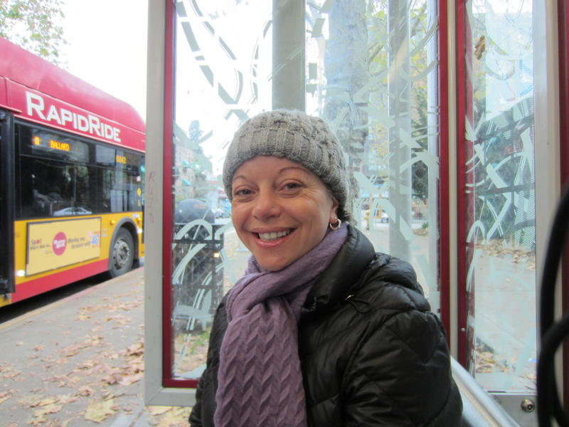Poet Nora Giron-Dolce at a Seattle bus stop.