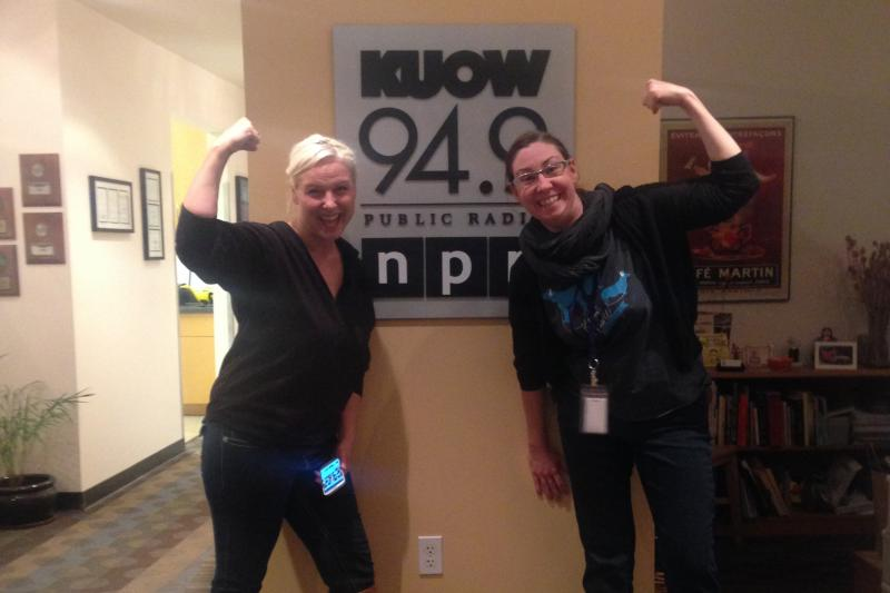 Arm wrestler Stephanie Browner and KUOW's Jeannie Yandel show off their biceps at the KUOW studios.