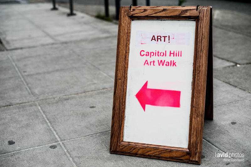 A sign points towards an exhibit as part of a 2012 art walk on Capitol Hill, Seattle.