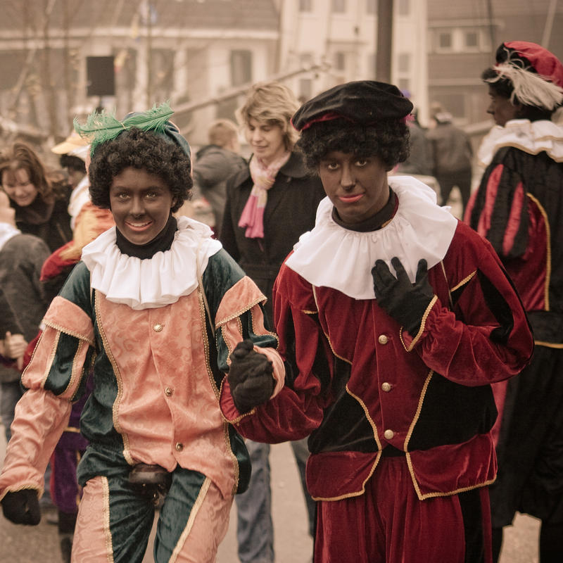 People in black face dress up as Black Peter, a traditional holiday figure in the Netherlands.