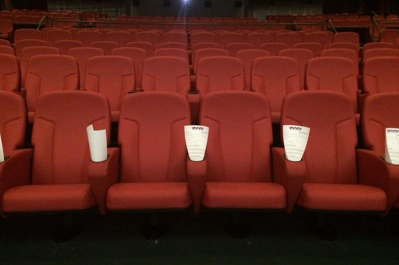 The theater revised its number of seats down from 798 to 570. The seats are leather and offer enough leg room for an average size adult woman to fully extend her legs (claim tested).