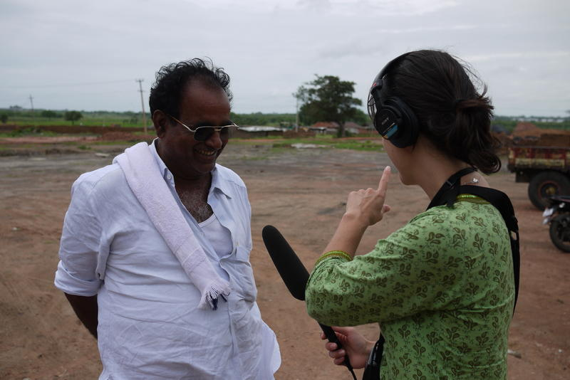 Liz Jones interviews the owner of a brick kiln while reporting the KUOW series, Two Indias