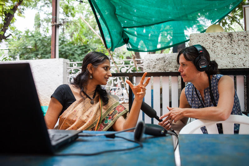 KUOW reporter Liz Jones conducting an interview in a farmers market in Hyderabad, India.