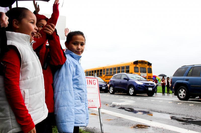 Crowds cheer Marysville HS buses