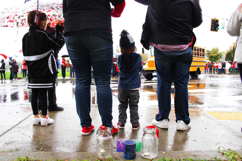 Crowds cheer Marysville High School buses as they returned to school a week after the shooting.