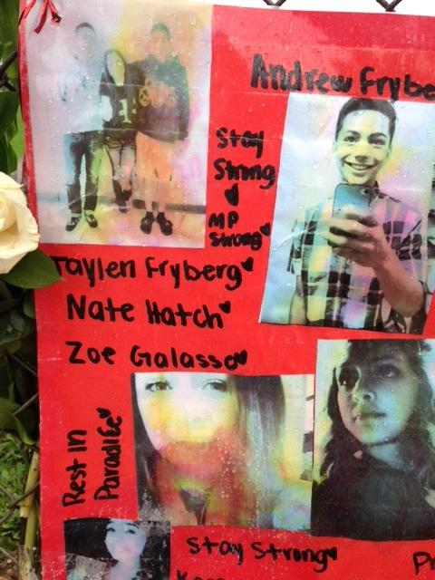 Photos of the students shot at Marysville-Pilchuck High School are seen in a memorial last year.