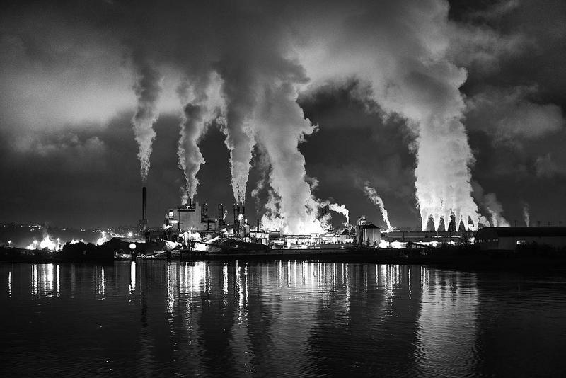 Smoke stacks during a night scene in Tacoma, Wash.