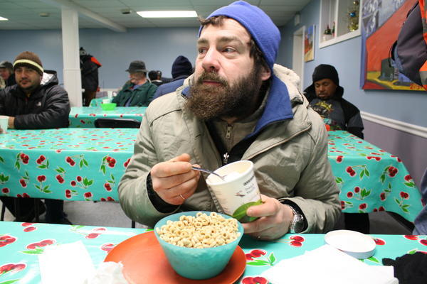 Justin Ingram ate two heaping bowls of cereal, a bowl of oatmeal, two pieces of toast with butter and a rare pint of ice cream for breakfast at St. Luke's Episcopal Church in Ballard on Tuesday morning. Still, he says he's lost 50 pounds while homeless