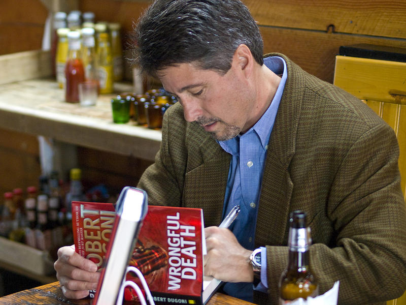 Author Robert Dugoni at a book signing at the Tin Room Bar & Grill in Burien, Wash., in 2009.