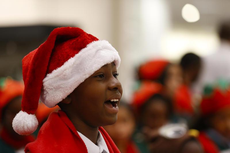 An Artherton Elementary School student sings for a Make-A-Wish child for National Believe Day at on Friday, Dec. 12, 2014, in Houston.