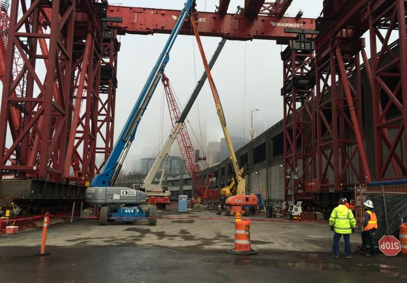 The giant red crane will lift Bertha's cutter head to the surface for disassembly