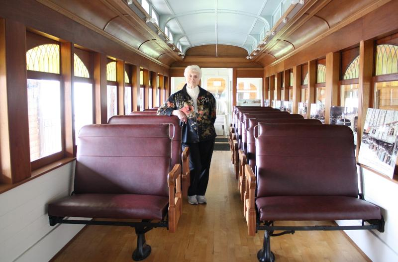 "Betty Lou Gaeng aboard a restored trolley that once ran the ""Interurban"" route linking Seattle to suburban communities like Alderwood Manor (now Lynnwood)"