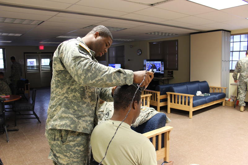 A soldier gets his hair cut in the Morale, Welfare and Recreation  building in the controlled monitoring area of JBLM.