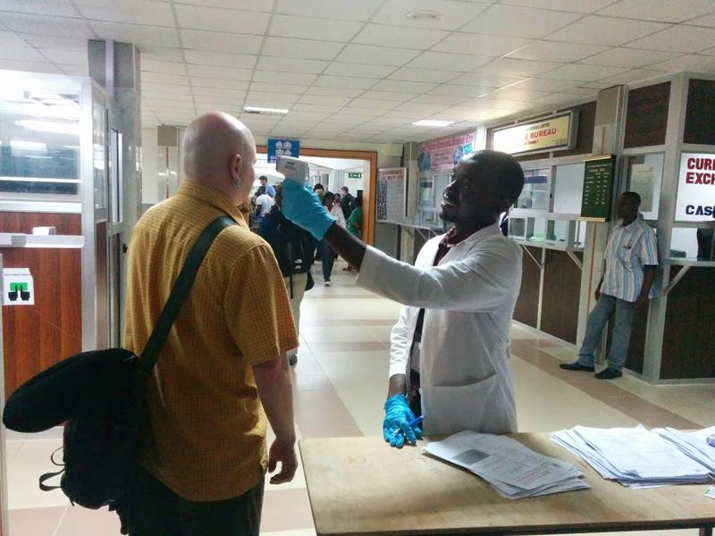 A colleague of Karin Huster gets his temperature checked at the Sierra Leone airport after passport control. It was the just the second of thousands the health workers would take while in country.