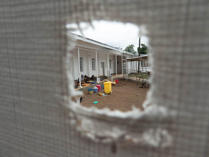 A view through the cloth of an Ebola holding center. Nurse Karin Huster wrote the sanitary conditions were little more than rudimentary.