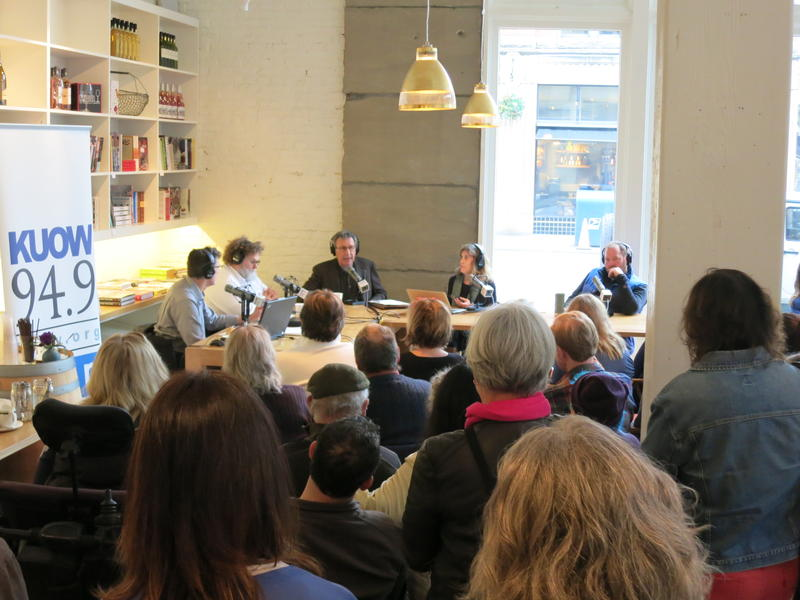 The 'Week in Review' panel broadcasts in front of a live audience at Little London Plane in Pioneer Square on Friday, Jan. 9, 2015.