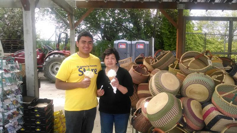Juan Andres Macedo with his mother at a farm stand in Mount Vernon.