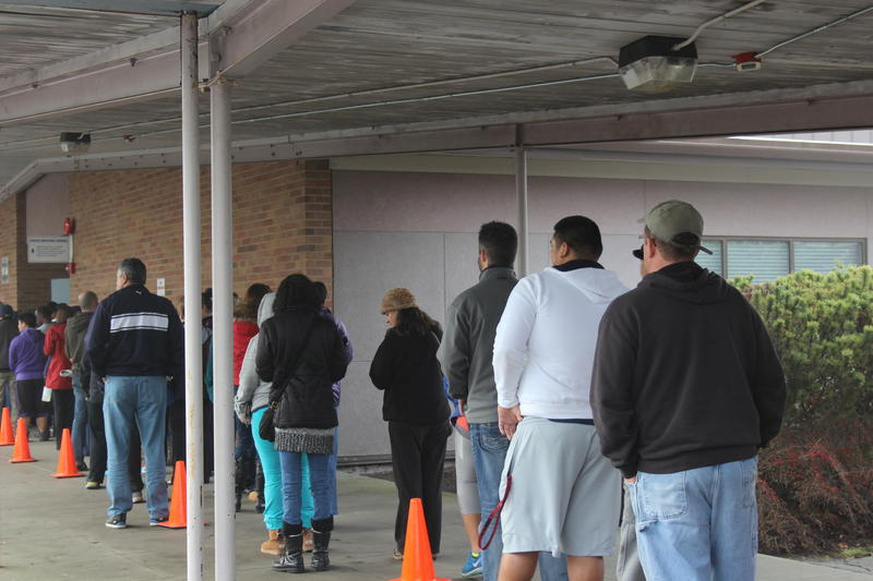 Parents wait in line outside a gymnasium at Spartan Recreation Center in Shoreline to reunite with their children following a lockdown of Shoreline schools on Wednesday, Jan. 7.