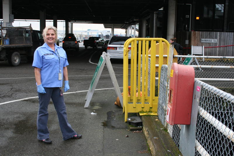 Kathy Powers works on the ferries on the dock in Seattle. She ran down between trips to look at the dead gray whale.