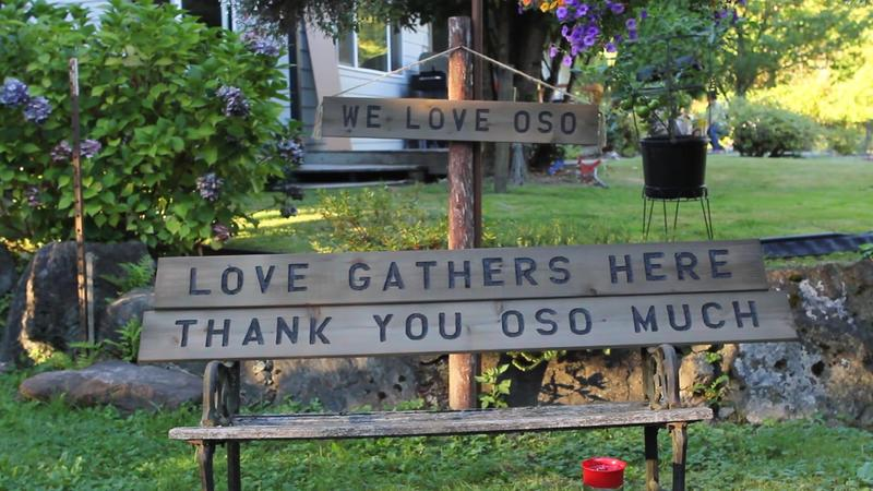 Ron Thompson, whose home was destroyed in the Oso, Washington, slide, had a full workshop. He continues to carve signs, including these at his new home behind the Oso fire station.