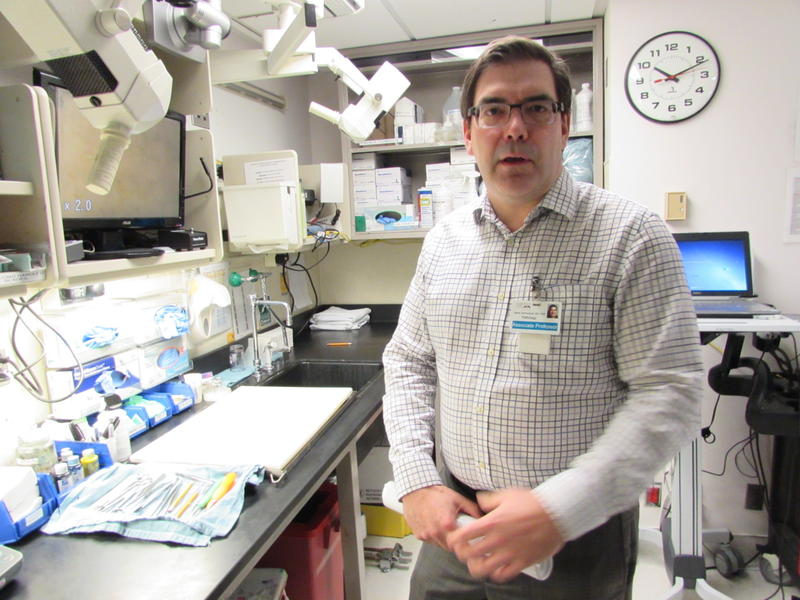 NWBio Trust director Dr. Stephen Schmechel shows where tissue samples are processed, steps from the operating room at the UW Medical Center.