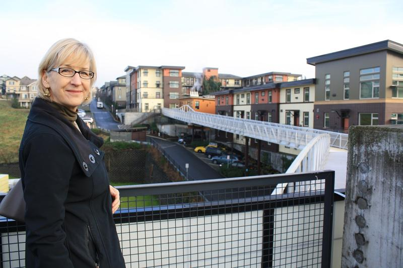 Issaquah head planner Lucy Sloman stands at the rail of the Issaquah Highlands park and ride.