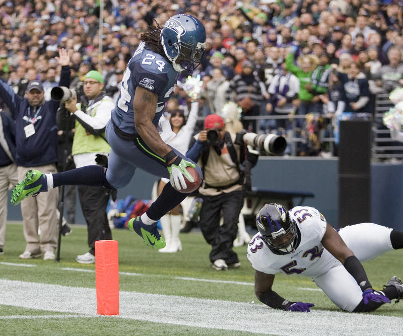 Seattle running back Marshawn Lynch makes a run against the Baltimore Ravens at CenturyLink Field in 2011.