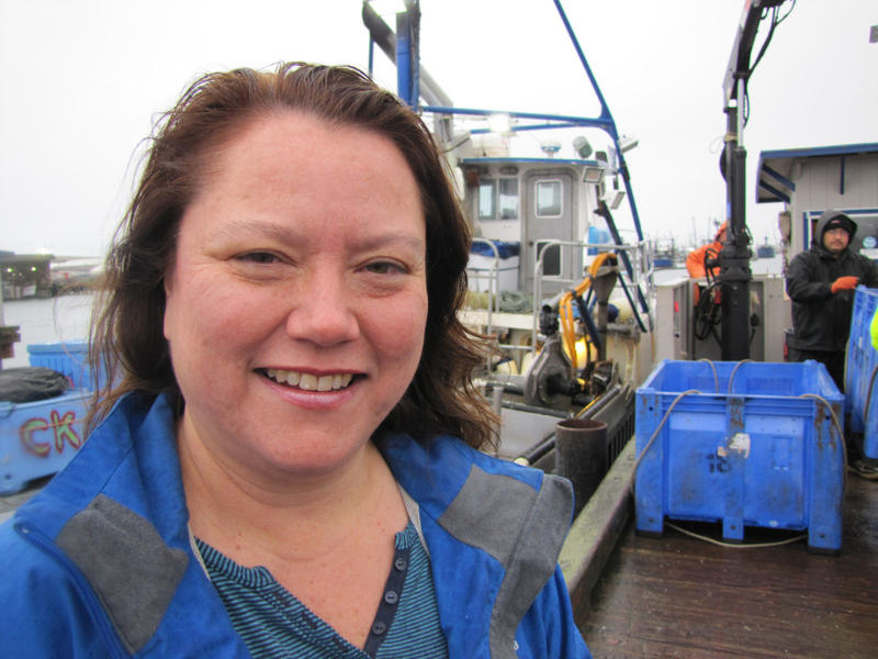 Fawn Sharp, president of the Quinault Indian Nation, stands on the docks as tribal crabbers unload their catch. The tribe has vowed to fight the oil train-to-ship terminals  proposed for Grays Harbor.