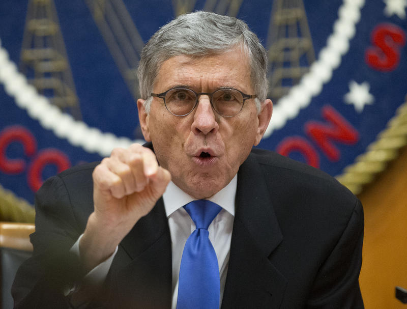FCC Chairman Tom Wheeler gestures near the end of a hearing for a vote on Net Neutrality, Feb. 26, 2015