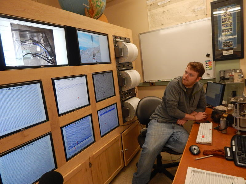 Research assistant Doug Gibbons surveys latest data in the Pacific Northwest Seismic Network.