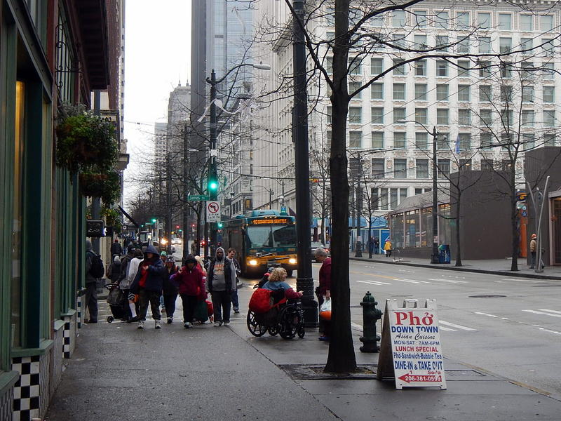 A line of homeless people outside a shelter in downtown Seattle.