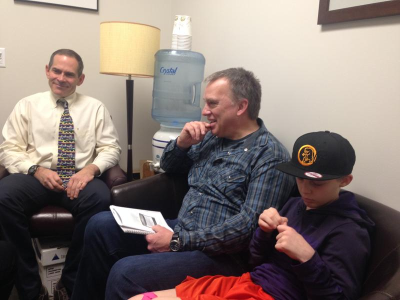 Dr. Stephen Tilles, the principle investigator for the peanut patch study in Seattle, with David Baty and his son Spencer, who suffers from a peanut allergy.