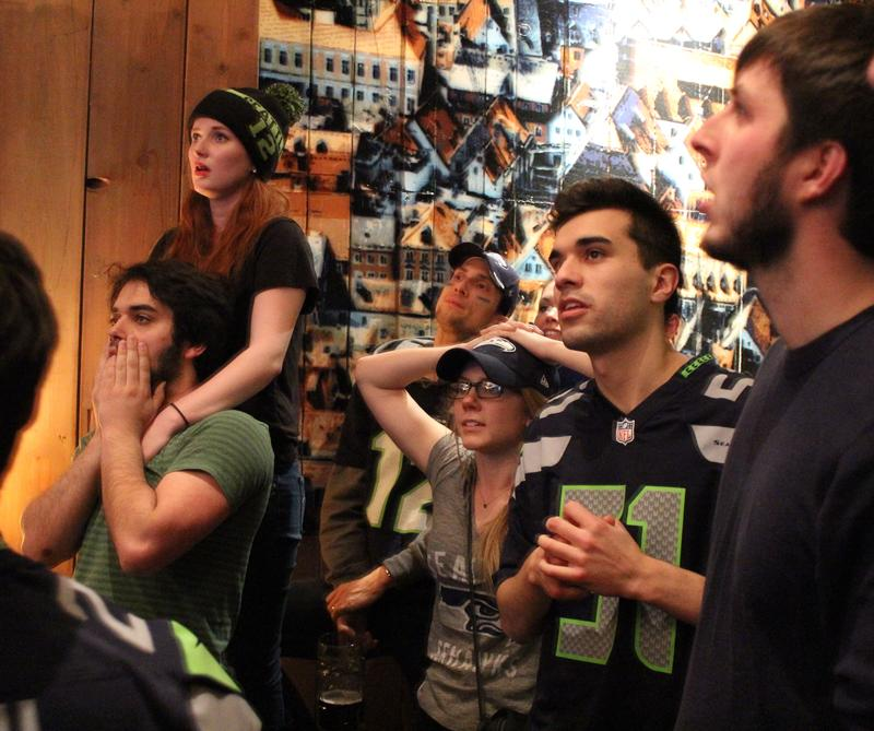 Stunned Seahawks fans at Altstadt in Pioneer Square watch as Seahawks go down to defeat in Sunday's Superbowl.
