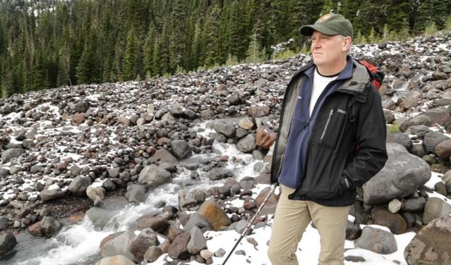 Jon Riedel, standing just below the Easton Glacier of Mount Baker. He has been monitoring glaciers for the National Park Service for more than 30 years. He's documented the rate at which glaciers in the North Cascades have been shrinking in recent years.