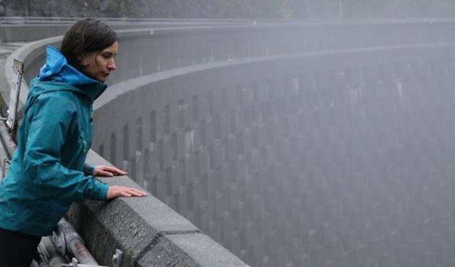 Crystal Raymond looks down over Ross Lake dam, one of the largest dams in Western Washington. She leads the climate change adaptation and research program for Seattle City Light.