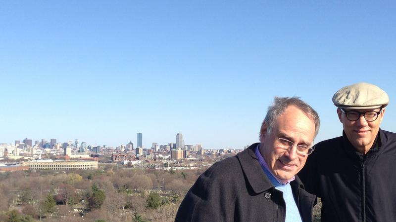 Richard Sher, host of Says You, left, and KUOW Programming Director Jeff Hansen, in the spring of 2014. They are standing on Sher's favorite spot in a gated cemetery in Boston.