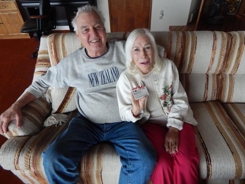Gloria Hoeppner holds her VA choice card with husband Earl Kornbrekke at their home in Friday Harbor, Washington.