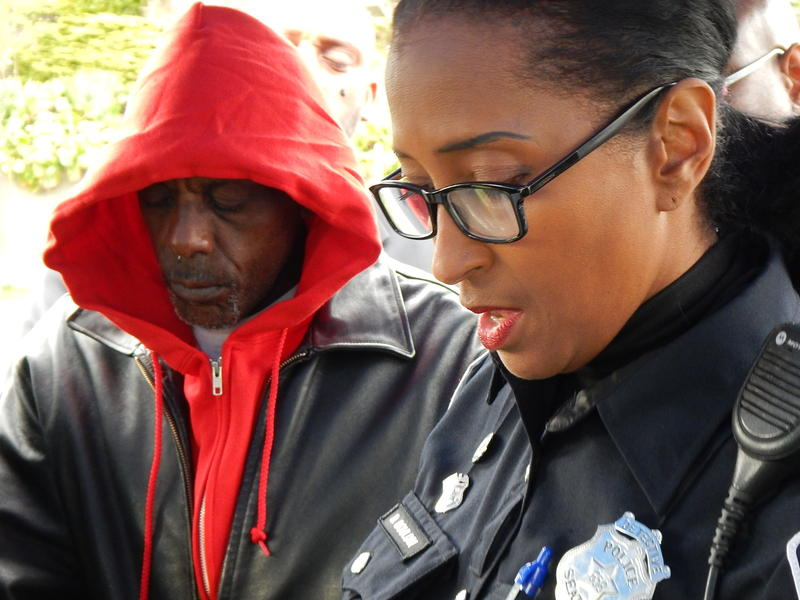 Robert Robinson listens as Seattle Police Detective D.