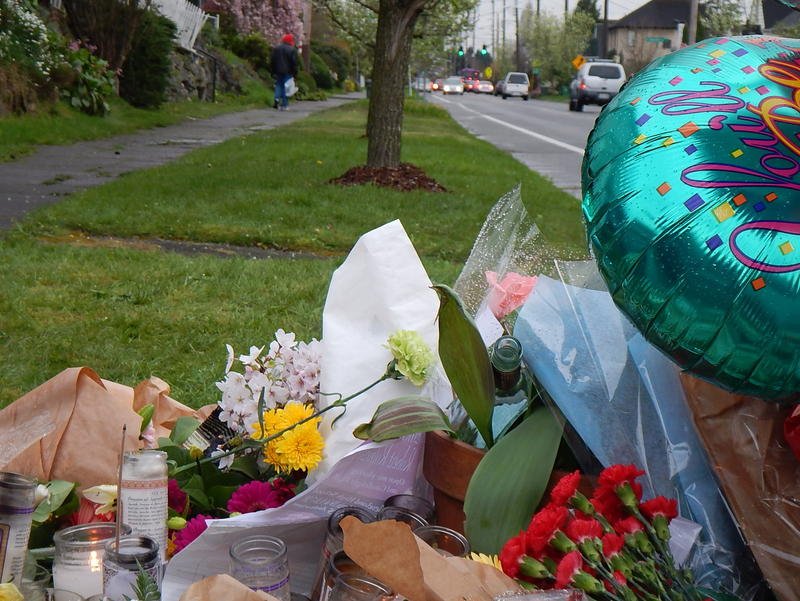 Robert Robinson walks home from a memorial for his slain son.