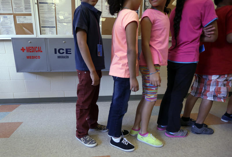 In this Sept. 10, 2014 file photo, detained immigrant children line up in the cafeteria at the Karnes County Residential Center in Texas. About 70 children from the border have been placed with foster families in Washington state.