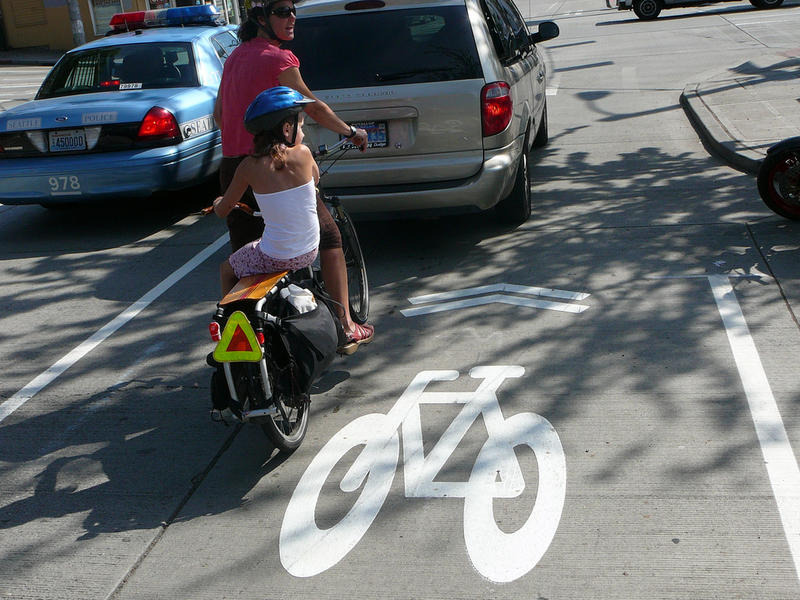 "An example of a ""sharrow,"" a painted icon intended to point the way for bikers on shared roads."