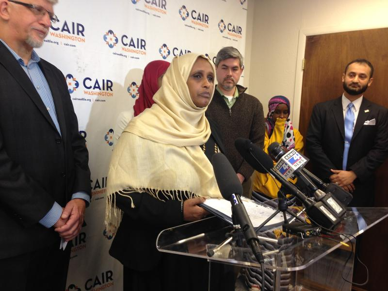 Asha Gobana says a man pointed a gun at her and made anti-Muslim threats.