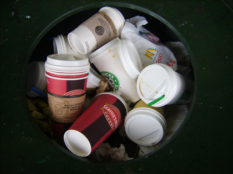Seattle trash filled with coffee cups.