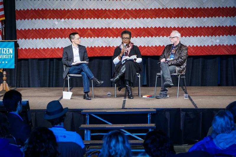Poet Claudia Rankine (center) speaks with moderator Eric Liu (left) and playwright, Robert Schenkkan at the Citizen University National Confernence at the Seattle Center in March.