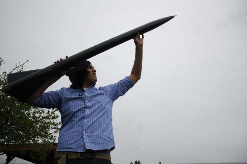 Christian Cultee, a student at the Northwest Indian College, with a rocket that broke the sound barrier.